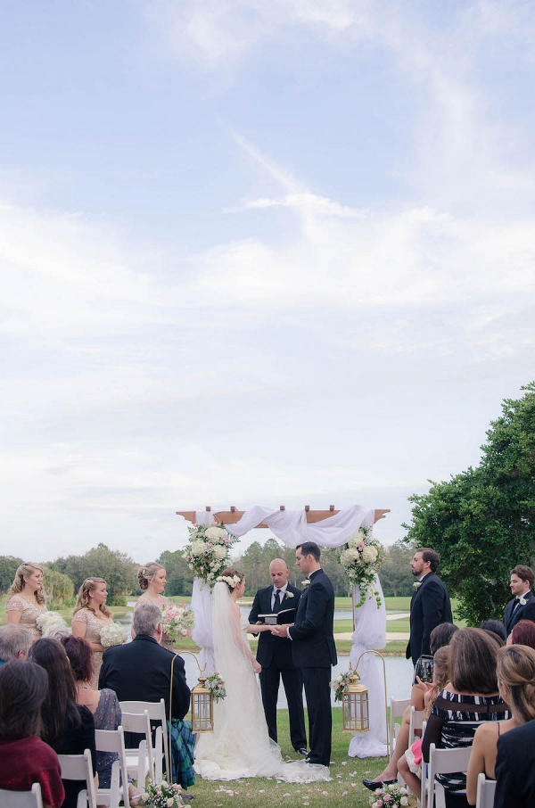 Bride and Groom Outdoor Wedding Ceremony with Arch and Draping