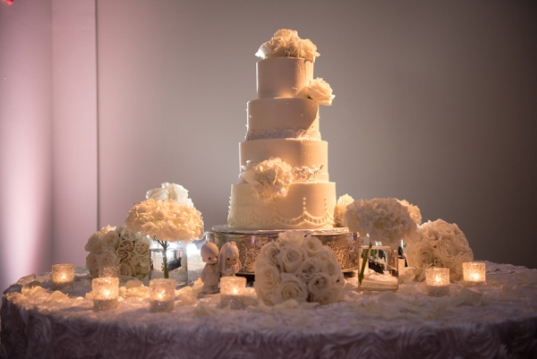 4 Tiered, Round, White Wedding Cake with White Floral Accents
