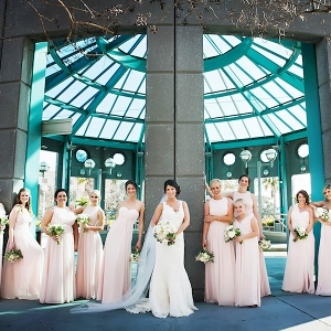 Outdoor, Bride and Bridesmaids Wedding Portrait in Blush Colored Bridesmaids Dresses