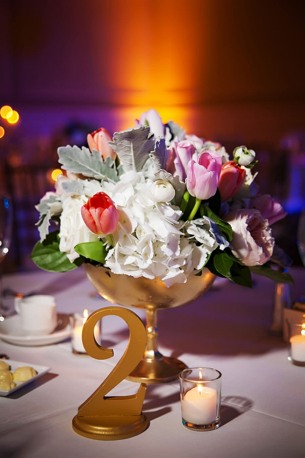 Wedding Reception Table Decor with Gold Table Numbers and Pink, Red, and White Floral Centerpieces with Succulents