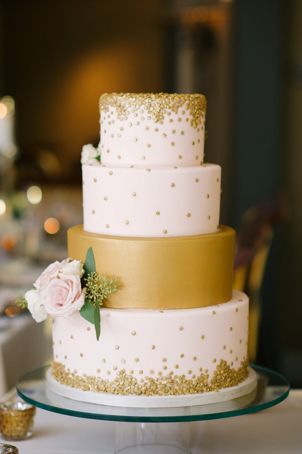 Four Tiered Round White and Gold Wedding Cake with Rose Floral Accent and Gold Sequins
