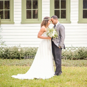 Bridal Wedding Day Portrait First Look with Groom with Strapless White Wedding Gown with White and Green Lush Bouquet with Floral Crown