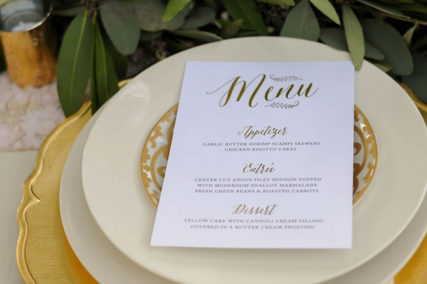 Wedding Reception Place Setting with Custom White Menu Card with Script Gold Accents and Gold Charger Plate