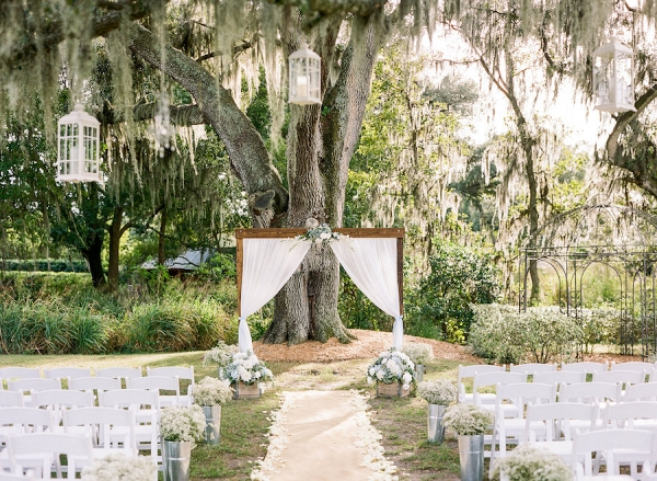 Rustic Outdoor Wedding With White Draped Altar And Folding Chairs