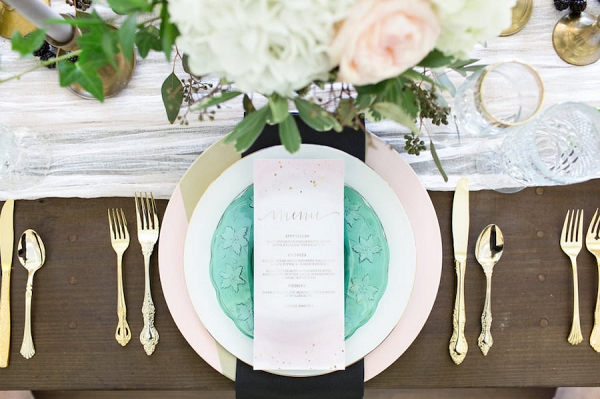 Ivory, White Rose and Blush Pink Wedding Centerpieces with Gold and Green Vintage China Charger and Gold Siliverware on Wooden Farm Table