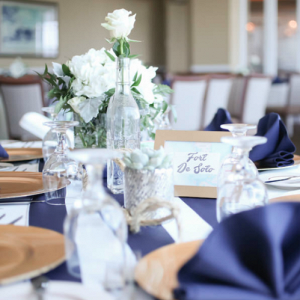 Blue, white, and gold centerpieces