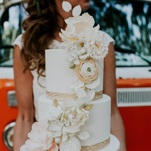 Sugar flower covered wedding cake