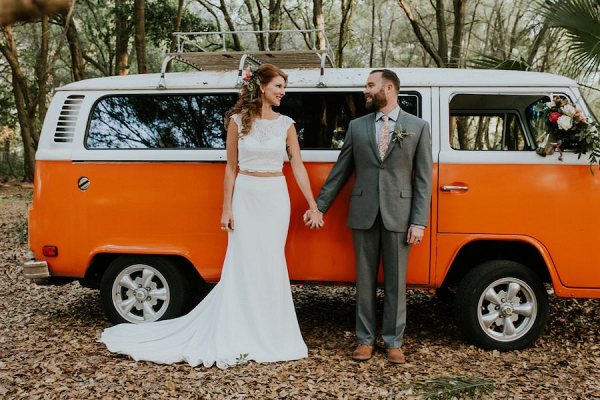 Couple in front of orange vintage van