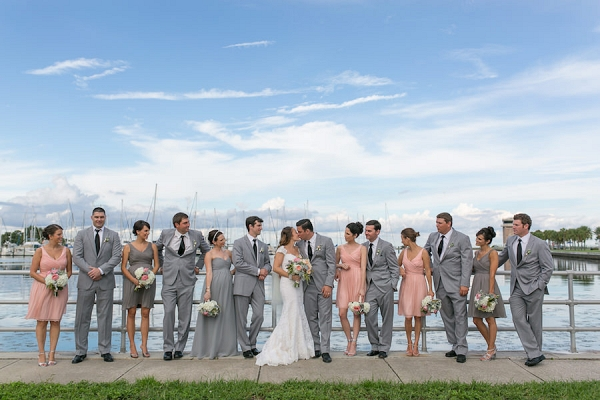 Outdoor Wedding Party Portrait in Grey and Light Pink Bridesmaid Dresses with Grey Groomsmen Suits | Waterfront Bridal Party Portrait