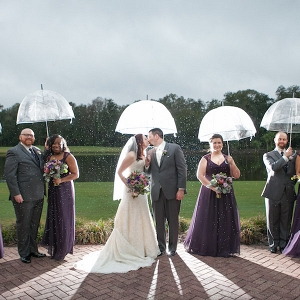 Outdoor, Bridal Party Portrait in the Rain with Clear Umbrellas and Purple Bridesmaids Dresses