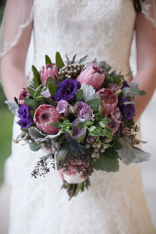 Bridal Wedding Portrait in Ivory, Lace Beaded Wedding Dress and Purple and Pink Floral Wedding Bouquet