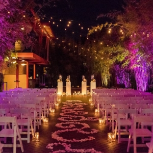 Outdoor, Nighttime St. Petersburg Wedding Ceremony Aisle with Pink Uplighting and Aisle of Flowers | St. Pete Wedding Venue NOVA 535