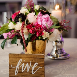Modern and Rustic Wedding Reception with Pink, White and Red Centerpieces in Gold Vase and Wooden Table Number