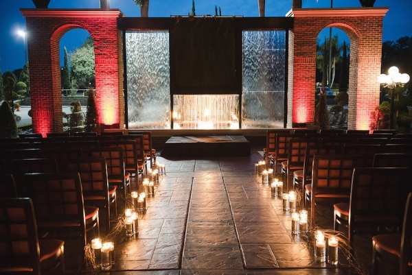Candlelit Wedding Ceremony Aisle with Waterfall Background