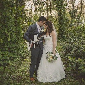 Bride and Groom In Woods Outdoor Wedding Portrait with Dog