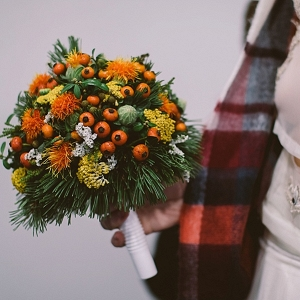 Orange and yellow bouquet on Mountainside Bride