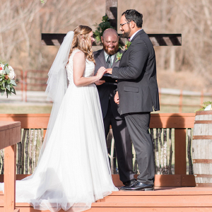 Evergreen and pinecone wedding ceremony