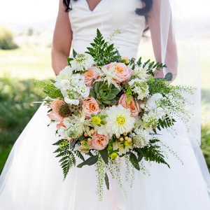 Peach floral and succulent bridal bouquet