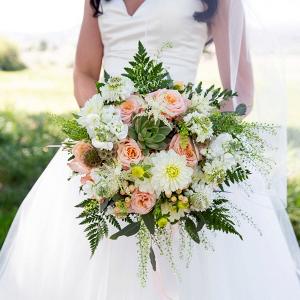 Peach floral and succulent bridal bouquet