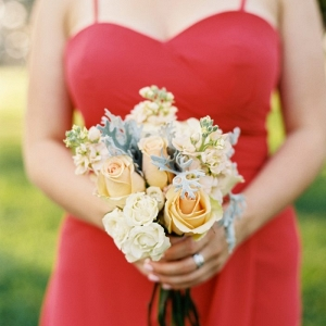 red bridesmaid dress with pink and peach bouquet