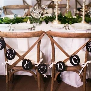"""We Do"" Wedding Chair Signs at a Vail Colorado Wedding"
