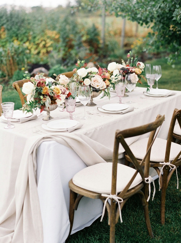 Romantic fall wedding table with warm color palette