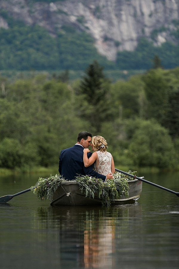 Couple in rowboat on lake