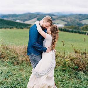 Windswept couple on Mountainside Bride