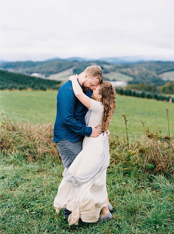 Windswept couple on Mountainside Bride