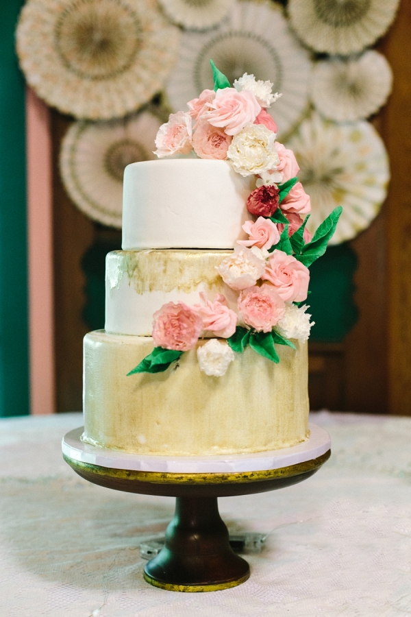 Gold painted wedding cake on Mountainside Bride