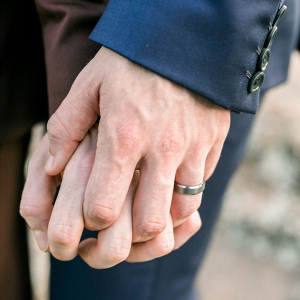 Hand in hand and a wedding band