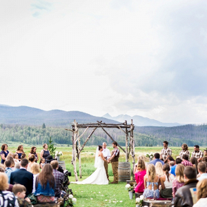 Rustic outdoor mountain wedding ceremony