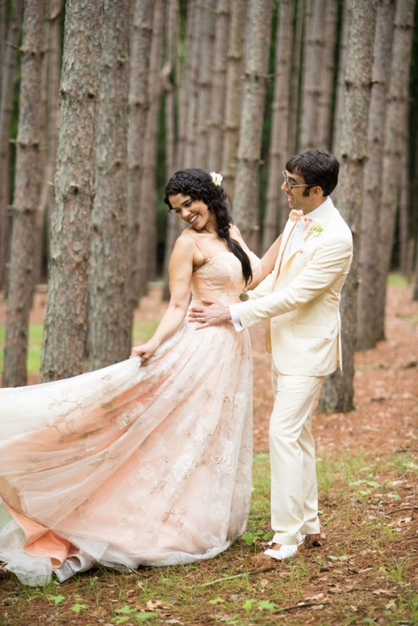Woodland bride in a pink wedding gown with her groom