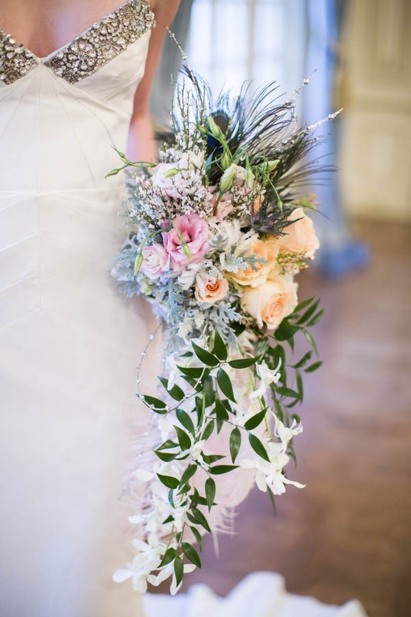 Cascading vintage bouquet with peacock feathers