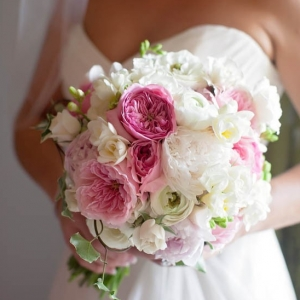 Elegant pink and white bouquet with peonies, roses, and ivy