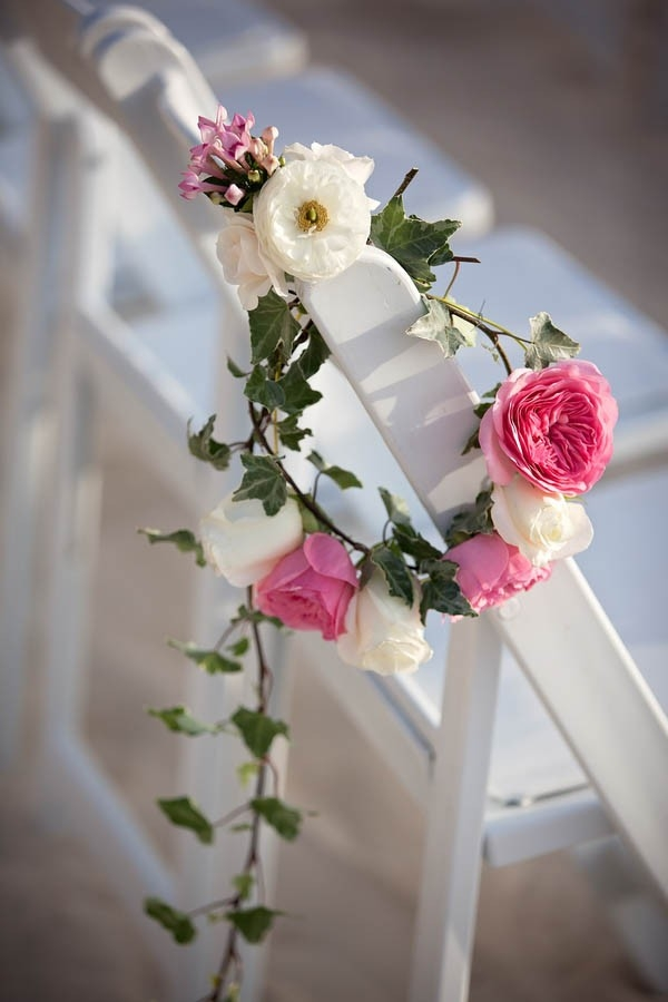 Pretty beach wedding aisle marker made with ivy and roses