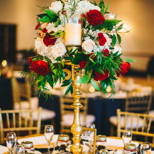 Tall burgundy and gold wedding centerpiece
