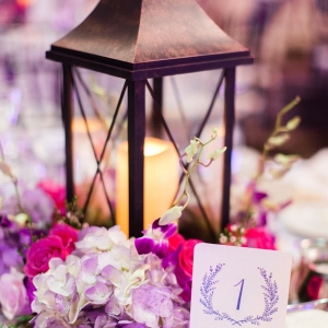 Romantic lantern centerpiece with hydrangea and roses