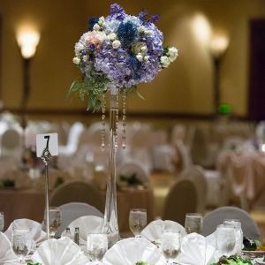 Elegant tall centerpiece with blue hydrangea and roses