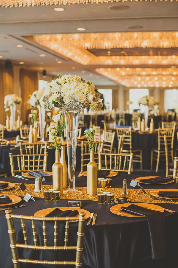 Black and gold ballroom reception