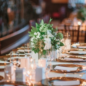 Elegant tablescape with rose gold chargers and chiavari chairs for an intimate reception