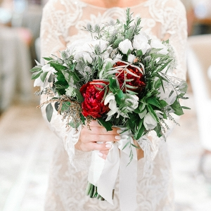 Romantic winter wedding bouquet with crimson peonies
