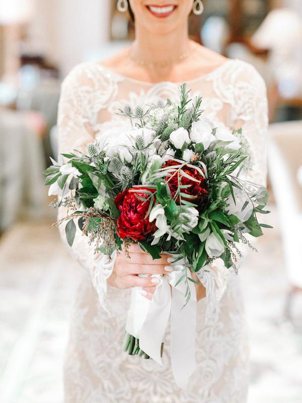 Romantic winter wedding bouquet with crimson peonies