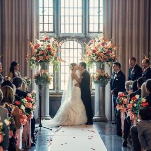 Elegant coral ballroom wedding ceremony at The Tudor Arms Hotel