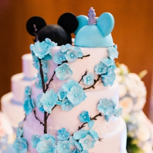 Elegant Disney wedding cake with Mickey Mouse ear cake topper