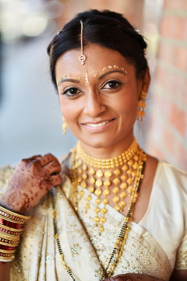 Elegant Indian bride wearing ivory and gold