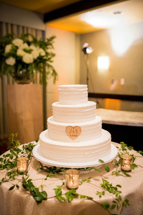 Simple, three-tier rustic wedding cake with wooden heart