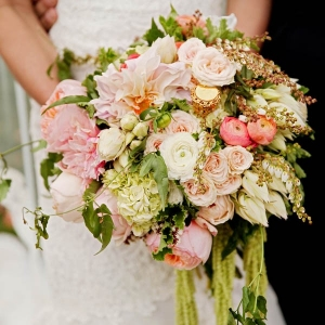 Luxe garden wedding bouquet filled with dahlias, garden roses, tea roses, ranunculus, hydrangea and Jasmine vines