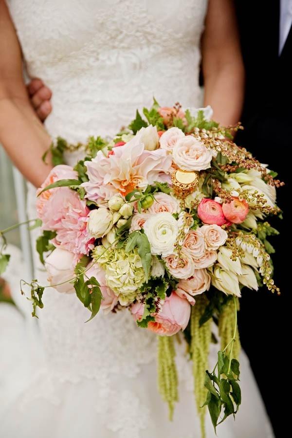 Luxe garden wedding bouquet filled with dahlias, garden roses, tea roses, ranunculus, hydrangea and Jasmine vines