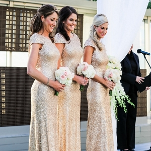 Long, gold glittery bridesmaid dresses